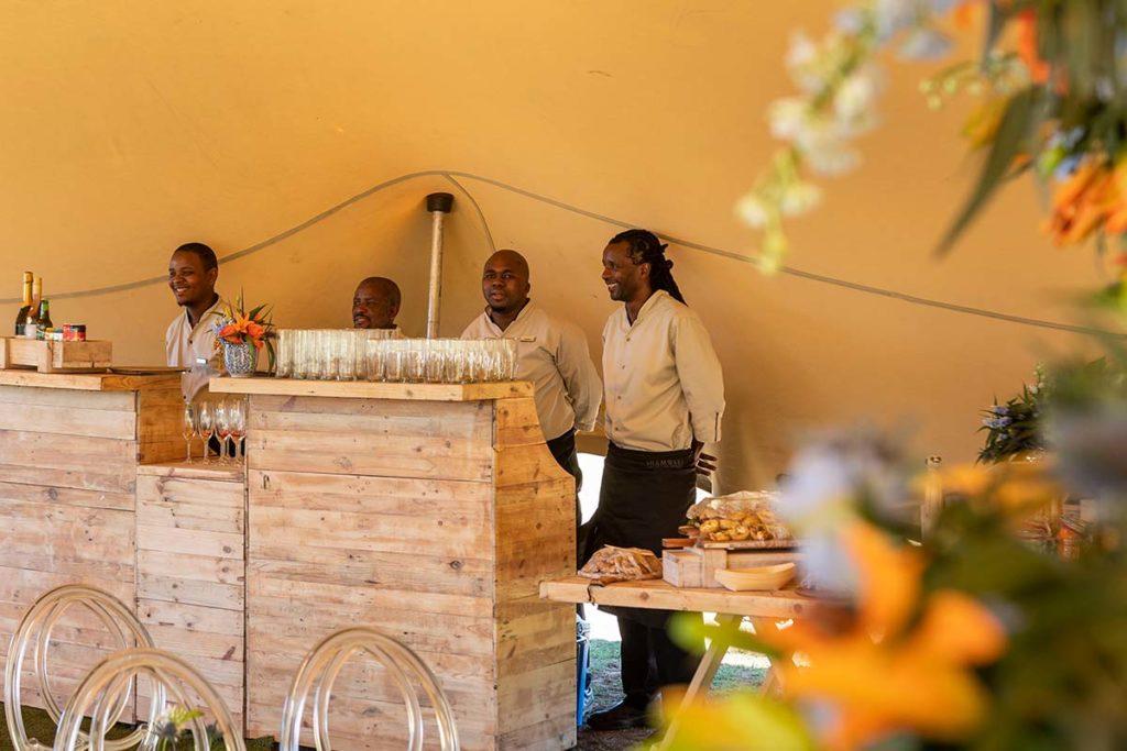 Shamwari's friendly staff manning the bar and snacks area at a wedding reception